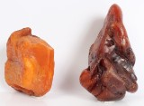 Danish amber, partially polished pieces, 410 g. (2)