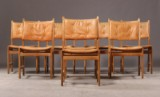 Kurt Østervig. Eight oak chairs with leather cushions (8)