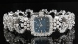 18kt Omega mekanisk ur med diamanter, ca. 5.50ct