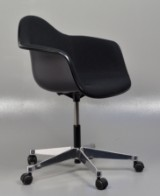 Charles Eames. Fully upholstered armchair on casters, model PACC, from 2015