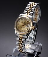 Rolex 'Datejust'. Ladies watch, 18 kt. gold and steel, with diamond dial - certificate 1994