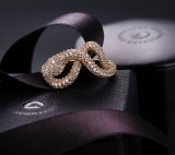 Ole Lynggaard. A small 'Snakes' ring, 18 kt. red gold with diamodns, total 1.24 ct.