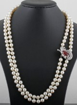 18kt. diamond and ruby 2 strand salt water pearls approx. 1.50ct