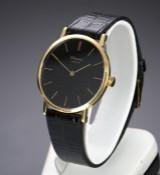 Chopard. Vintage men's watch, 18 kt. gold with dark dial, c. 1970s