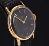 IWC Schaffhausen. Vintage ladies watch, 18 kt. gold with black dial, c. 1961