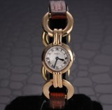 Cartier. Vintage ladies watch, 18 kt. gold with silver-coloured dial, c. 1920-30