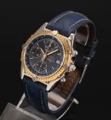 Breitling 'Chronomat'. Herrechronograf i 18 kt. guld og stål med mørkeblå skive, 1990' erne