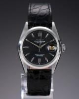 Rolex 'Date'. Vintage men's watch, steel with black dial, 1950s