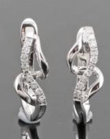 18kt. diamond earrings approx. 0.12ct