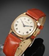 Rolex. Vintage unisexur i pudeformet urkasse af 9 kt. guld