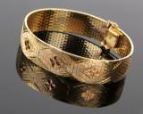 A. Halberstadt. Armbånd af 18 kt. guld i tre farver