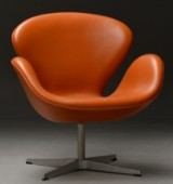 Arne Jacobsen. The Swan easy chair, model 3320, cognac-coloured leather