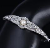 Diamond bracelet, 18 and 8 kt. white gold, 20th century-beginning