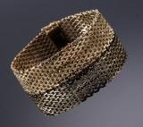 Emil Christiansen, Odense. Bred armlænker af 14 kt. guld