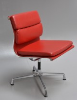 Charles Eames. Soft Pad chair, model EA-206, Ferrari red leather