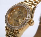 Rolex 'Datejust'. Ladies watch, 18 kt. gold, with diamond dial, c. 1994