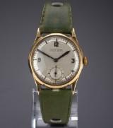 Ulysse Nardin. Vintage midsizeur i 18 kt. guld med lys skive, 1930´erne