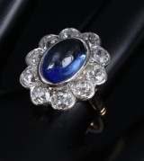 A sapphire and diamond rosette ring, gold and white gold. Sapphire approx. 3.95 ct. Diamonds, total approx. 2.20 ct. 20th century-first half