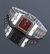 Cartier 'Santos Gelbee'. Herreur i 18 kt. guld og stål med bordeaux skive, 1980/90'erne