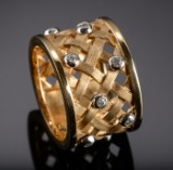 Ole Lynggaard. A large ring, woven pattern, with diamonds