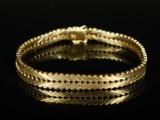 Armbånd af 8 kt. guld. Genevemønster