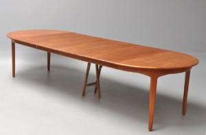 Henning Kjærnulf. Round teak table with four extension leaves. Model ...