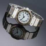Cartier 'Santos Lady'. Automatisk dameur i 18 kt. guld og stål med hvid skive, 1990'erne