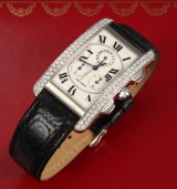 Cartier 'Tank Americaine'. Unisex chronograph, 18 kt. white gold with diamonds