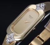 L.U. Chopard. Vintage dameur i 18 kt. guld med champagnefarvet skive og brillanter, 1970'erne