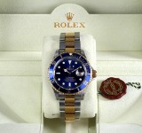 Rolex 'Submariner'. Men's watch, 18 kt. gold and steel, with blue dial - box + certificate 2008