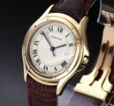 Cartier 'Cougar'. Herreur i 18 kt. guld med original rem og spænde, ca. 1990'erne