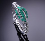 An emerald and diamond ring, 18 kt. white gold, diamond total approx. 4.85 ct