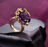 Ole Lynggaard. 'Blomsterkurv', large model, 18 kt. gold with amethyst and diamonds