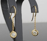Earrings in 14k set with brilliant cut diamonds 0.74 ct