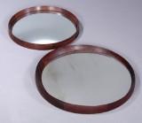 Ubekendt møbelproducenter. Større og mindre runde spejle i ramme af palisander