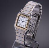 Cartier 'Santos Automatic'. Men's watch, 18 kt. gold and steel, with date