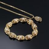 A. Michelsen. Vintage armlænke og vedhæng af 14 kt. guld og hvidguld med brillantslebne diamanter