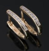 Ørestikkere, 14 kt guld prydet med mindre diamanter