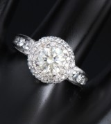 A diamond rosette ring, 14 kt. white gold. Total diamond carat approx. 2.11 ct.