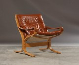Ingmar Relling. lavrykket lænestol med stel af formspændt bøgetræ