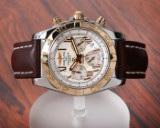 Breitling. 'Chronomat 44'. Men's watch in 18 kt. gold and steel with silver dial, the 2010s