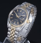Rolex 'Datejust'. Vintage men's watch, 18 kt. gold and steel with black dial, c. 1970