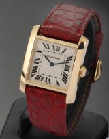 Cartier 'Tank Francaise'. Ladies watch, 18 kt. gold with sapphire