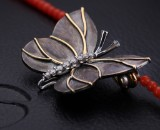 Ole Lynggaard. 'Katrine' clasp/Sweet Spot, 18 kt. sort red gold with diamonds, 0.09 ct., with coral necklace (2)