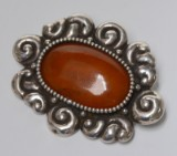 Thorvald Bindesbøll. Art Nouveau silver broche with amber