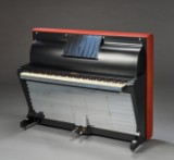 Poul Henningsen. 'PH-Pianino'. black-lacquered wood, covered in leather and chromed brass