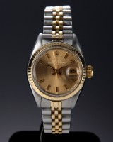 Rolex 'Date'. Ladies watch, 18 kt. gold and steel with champagne-coloured dial, c. 1979