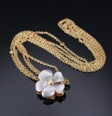 Ole Lynggaard. A large flower clasp, 18 kt. satin-finish gold and white gold as well as three-strand necklace (2)
