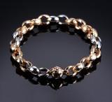Per Borup. Armlænke af 14 kt. guld og hvidguld med brillantslebet diamant.