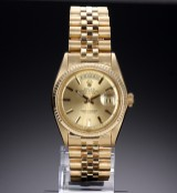 Rolex 'Day-Date'. Herreur i 18 kt. guld med champagnefarvet skive, ca. 1965